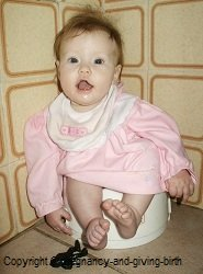 Infant on potty at 5 months